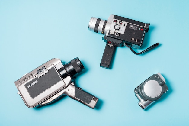 Different type of camcorder on blue background