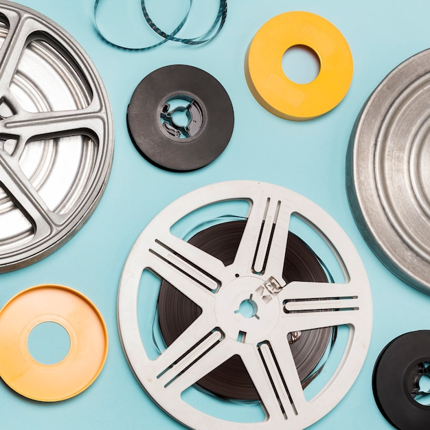 Different type of film reels against blue background