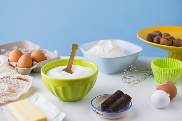 Different type of ingredients for making cake on table