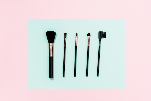 Different type of makeup brushes on dual background
