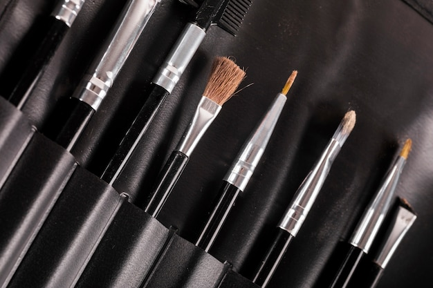Different type of makeup brushes in a row