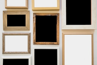 Different type of blank picture frame on wall