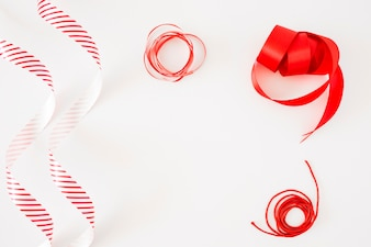 Different type of curled ribbons on white background