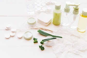 Different type of natural cosmetics product on white wooden table