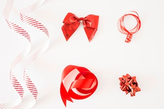 Different type of red ribbons on white background