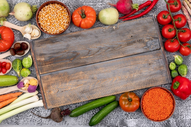 Different type of vegetables around the wood cutting board