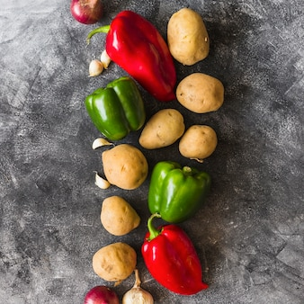 Different type of vegetables on stained concrete background