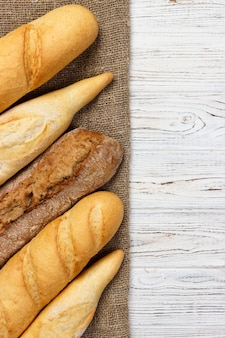 Different types of baguette on a wood