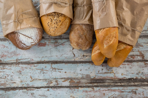 Different types of bread wrapped in paper bag