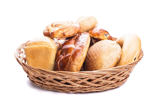 Different types of breads and buns in the basket on a white