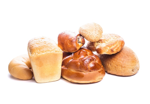 Different types of breads and buns isolated on white