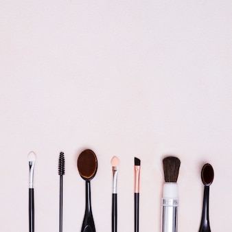 Different types of brushes in row with copy space on white background