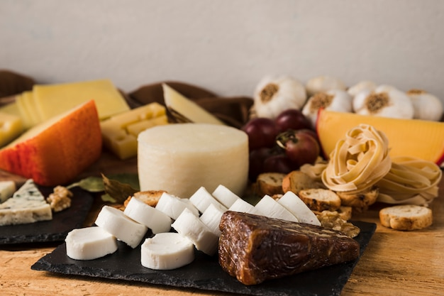 Different types of cheeses and ingredient on table