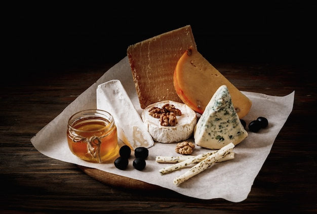 Different types of cheeses. slices of cheese brie or camembert with parmesan