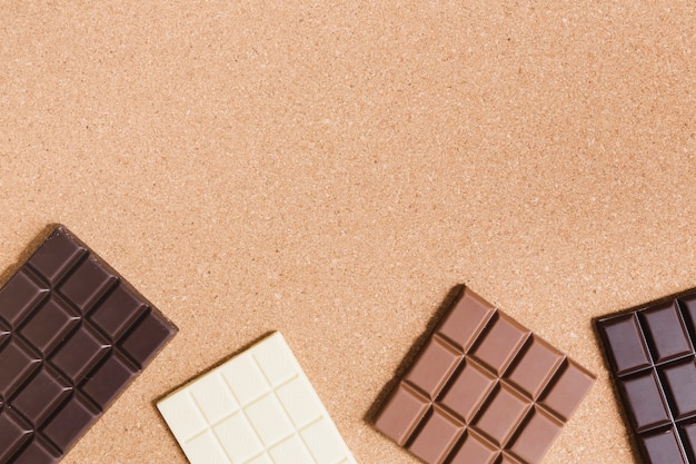 Different types of chocolate on orange background