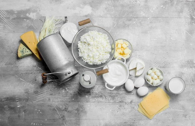 Different types of dairy products. on a rustic table.
