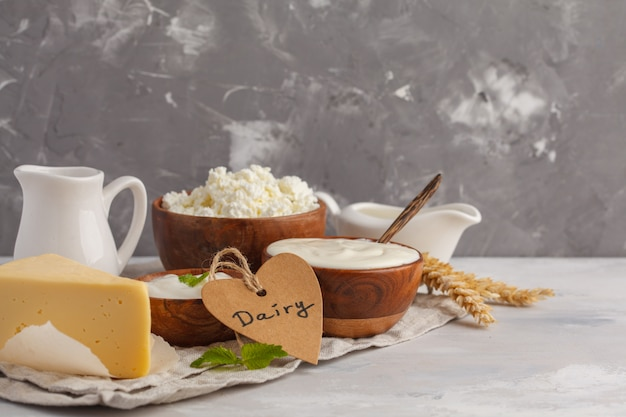 Different types of dairy products on white gray background, copy space. food background, healthy food concept
