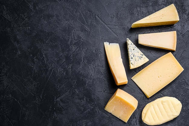 Different types of delicious cheese. top view. copyspace background
