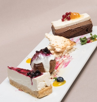Different types of dessert placed on white plate