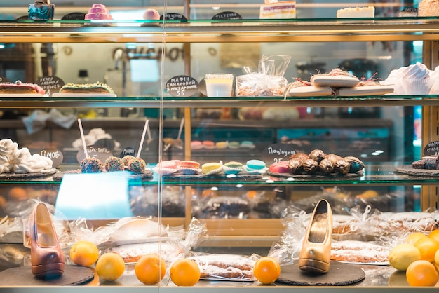 Different types of desserts in the glass cabinet