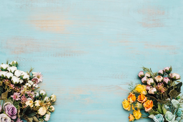Different types of flowers with blue vintage background.