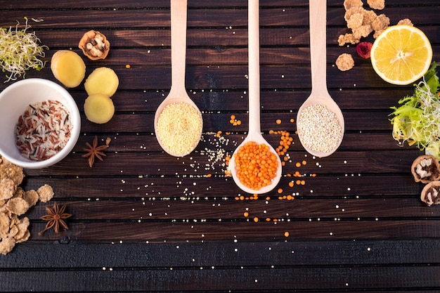 Different types of grains in spoons with rice