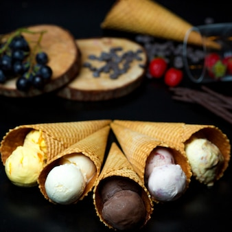 Different types of ice cream in crispy waffles
