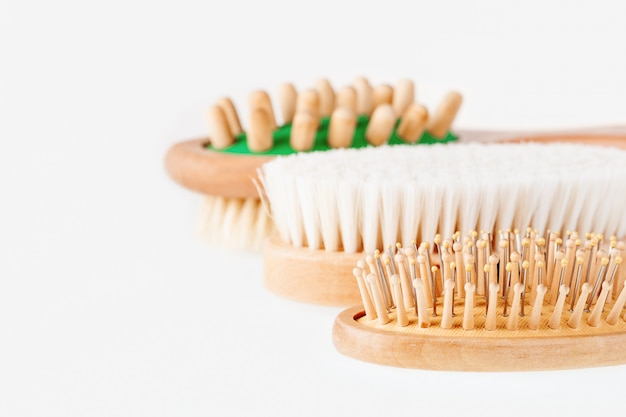 Different types of massage and hair brushes.