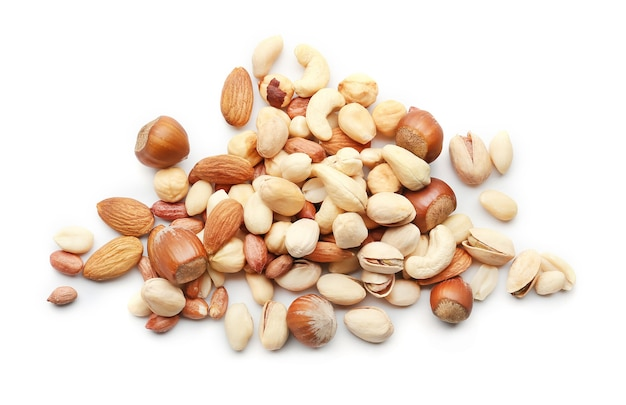 Different types of nuts on white