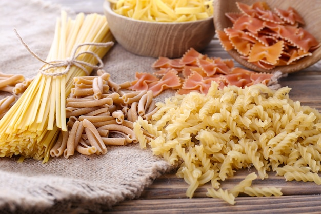 Different types of pasta on sackcloth