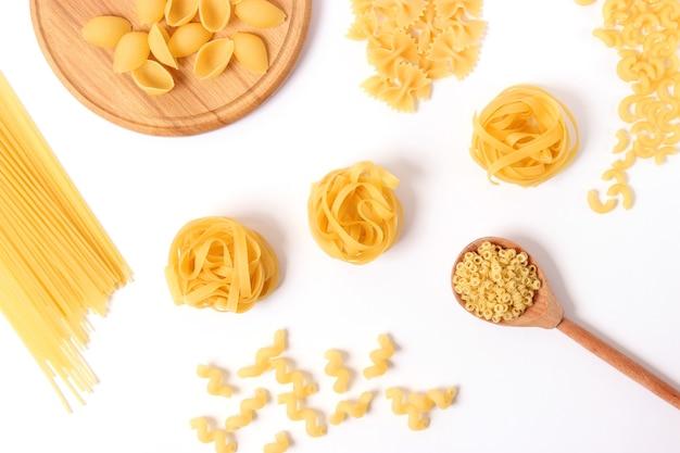 Different types of raw italian pasta closeup