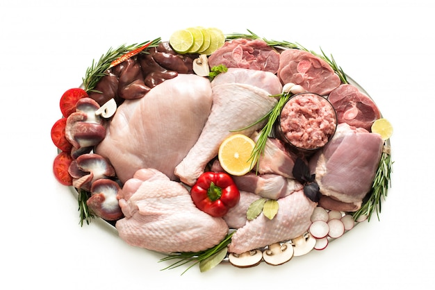 Different types of turkey meat and chicken, steaks, carcass poultry for cooking, top view on a wooden board, isolated. flat lay, cooking concept