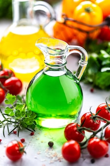 Different types of vegetable oil in glass bottles: sesame, linseed, grape oil.