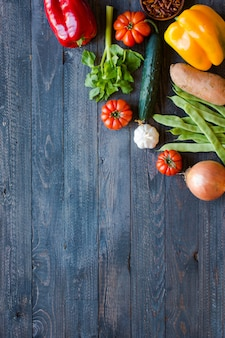 Different types of vegetables, on a old wooden table, background copyspace