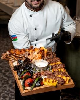 Different varieties of kebab with grilled vegetables