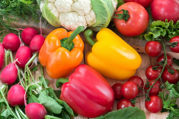 Different vegetables as a tomatoes, cauliflower, peppers, radishes, cherry tomatoes