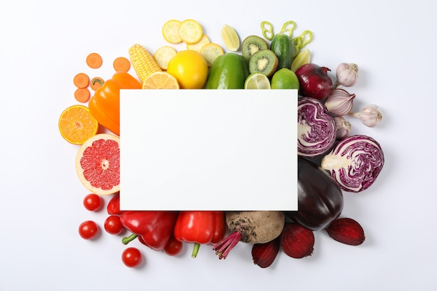 Different vegetables and fruits with empty space, top view
