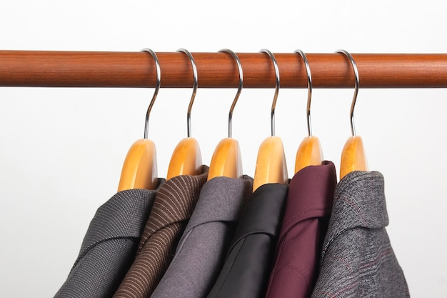 Different women's office classic jackets hang on a hanger for storing clothes. the choice of style of fashionable clothes.