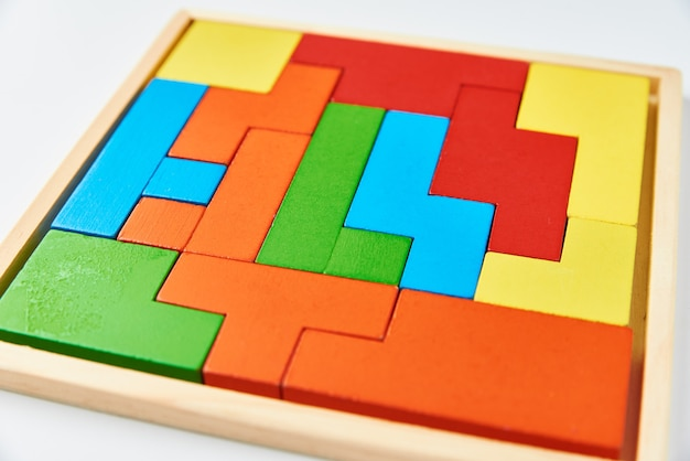 Different wooden blocks on a white wall. concept of logical thinking and education