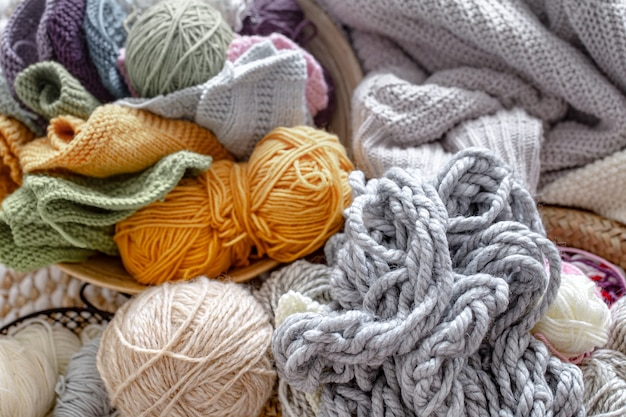 Different yarn for knitting in pastel and bright colors close up.