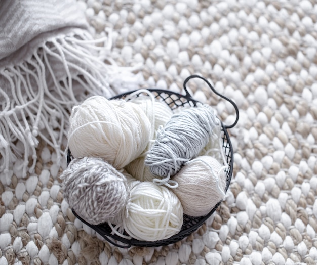 Different yarn for knitting in pastel colors.
