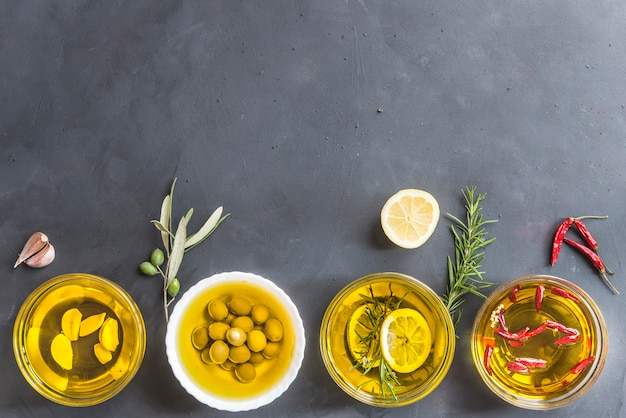 Differents oils rosemary and lemon, chilly, garlic and olive