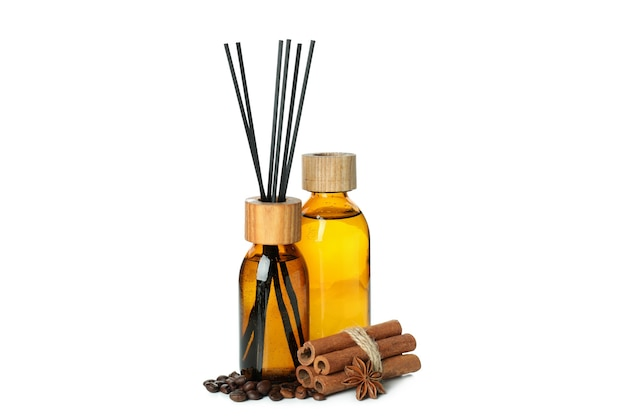 Diffusers, coffee beans and cinnamon sticks isolated on white background