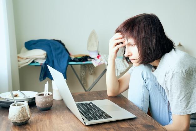 Digital addiction, woman in panic reads articles about coronavirus on internet