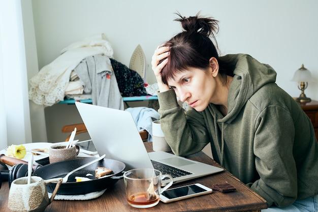 Digital addiction, woman in panic reads articles about coronavirus on internet.