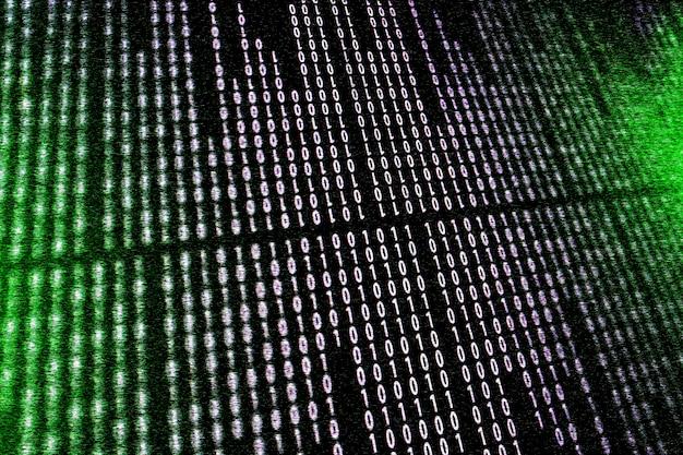 Digital binary data and streaming binary code on computer screen.