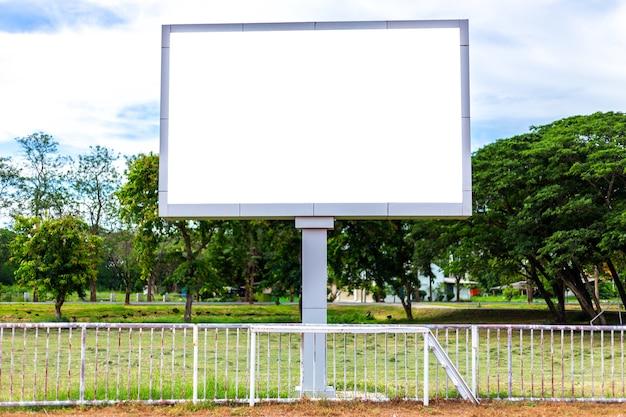 Digital blank scoreboard at football stadium with running track in outdoor