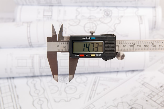Digital caliper on a print engineering drawings