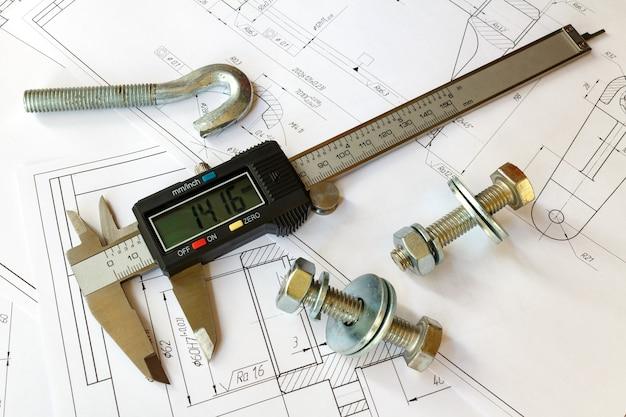 設計図にボルトとナットが付いたデジタルノギス