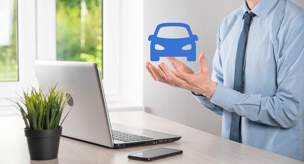Digital composite of man holding car icon.car automobile insurance and car services concept. businessman with offering gesture and icon of car